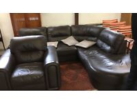 Large leatherette corner sofa and armchair.