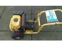 Two petrol pressure washers