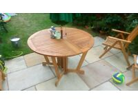 Hardwood Round Garden Table brand new, wrapped and boxed