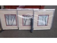 Set of 3 large framed pictures. Cream/red. Abstract trees.