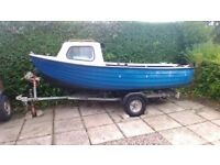 Fishing boat and trailer.