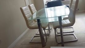 Glass table and leather chairs