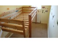 Child's wooden cabin bed