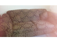 2 settees both 2 seater, one large and one smaller. Black and gold