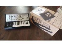 Moog Sub Phatty analogue synth with box