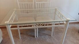 Glass Topped Dining Table with Cream painted metal Frame and 4 matching upholstered Chairs