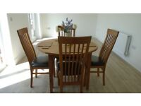 Solid oak dining set. Tickets still on chairs. Beautiful heavyweight solid oak table diameter 110cm