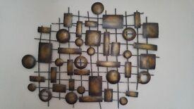 Wall hanging wrought metal artwork