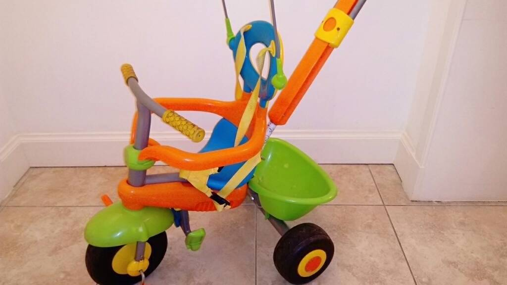 Yellow, blue and orange Smart Trike Plus for toddlers