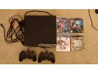 Sony Playstation 3 250GB 2 Controllers and 4 Games