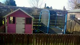 Kids playhouse and trampoline.