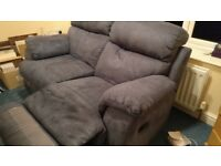 Blue double recliner two seater sofa. Good condition, hardly used.