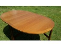 Beautiful oval solid teak drop leaf table hardly used.
