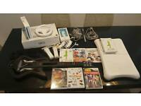 Wii including guitar hero, Wii Fit, Wheel + 6 Games