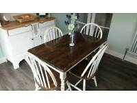 Country style rustic table with four chairs