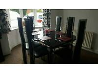 ***Extendable Glass table and 6 chairs***