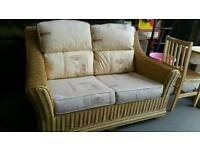 Wicker sofa with pattern cushions excellent condition