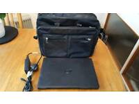 Laptop charger and carrying case