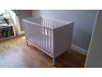 White IKEA cot in very good condition. Mattress included.