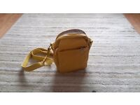 Ladies small yellow hand bag with shoulder strap