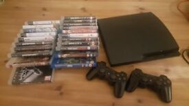 Ps3 slim with two controllers and games