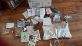 wii console complete + wii fit and some games