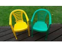 Two children's plastic chairs - playroom or garden