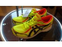 ASICS men's running shoes. Size: UK 7.5/Euro 42. Colour: Yellow/red/black.