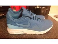 Baby blue & white Nike air trainers