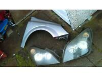 Astra mk5 parts lights , panels , exhaust ,gearbox , coil pack and a wing
