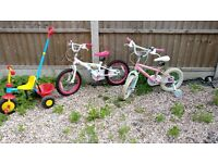 Two children's bikes (16 and 14 inch) and one toddler trike