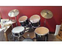Full set of black Mapex drum kit.
