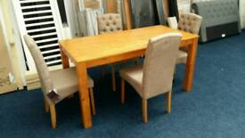 £145 - Salford 150cm dining table with 4 Aurelia Fabric Chairs - new and unused - delivery available