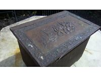 Antique brass embossed fireside log/coal storage box on dinky little casters