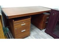 Excellent quality solid wood desk. Around five foot by 2 foot 6.