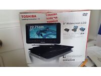 Toshiba SDP92SKB 9-Inch Portable DVD Player. In box never used.