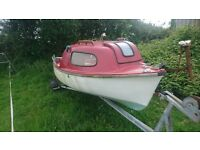seasafe boat 14ft, with trailer and suzuki 4hp outboard.