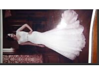 Size 10 Ivory Justin Alexander Style number: 8689