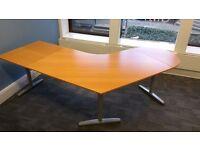 1 large curved desk, light coloured wood, metal legs