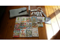 Nintendo Wii plus Wii fit board, controllers, cables and games