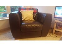 Brown leather armchair, excellent condition. H72cm, W108cm, D92cm. £50. Collection only.