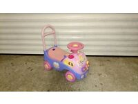 Kids ride on car / baby walker - pink and purple