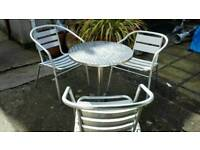 Aluminium patio table and 3 chairs lovely condition