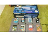 Nintendo nes boxed all leads and 8 games