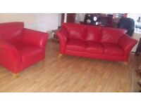 Modern 3+1+puffet red leather suite in excellent condition. Delivery can be arranged if required.