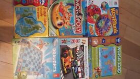 Several kids board games and jigsaws