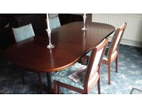 Table and 4 chairs. Dark wood extending oval table seats 4 - 10. Collection only.