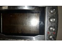 Electric table oven cooker with 2 hobs
