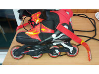 Inline adjustable roller skates - Roces - plenty of use left in them. Youth Size 4 to 7 UK