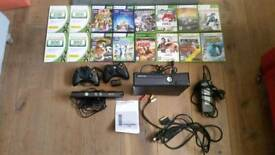 Xbox 360 with kinect, 2 controllers, and 12 games